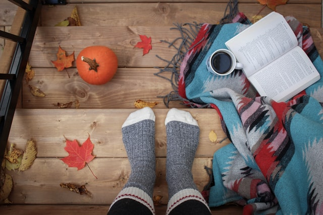 Keep cozy with blankets and socks for a lower heating bill!